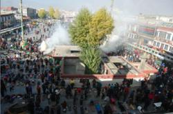 Tibetan people doing full-body-prostration in front of Jokhang Temple