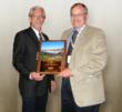 Art Hance, President of Hance Construction receives Building of the Year Award from Tim Seylor,  MBCEA President