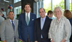 Pictured from (left to right): Bob Carinci, COO, Curry Automotive; Bernard F. Curry, CEO/Owner, Curry Subaru-Hyundai; Larry Gottlieb, Director of Economic Development, Westchester County; and Linda Puglisi, Supervisor, Town of Cortlandt.