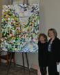 "The abstract painting ""Mystery of the Deep, Dark Forest"" is enjoyed by artist Louise Snyder Phillips and Alaska Regional Forester Beth Pendleton at Forest Service Headquarters in Washington, D.C."