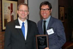 Aaron Chernow, Brightwing CEO, accepts Economic Bright Spot award from Phil Bahr of Rehmann.