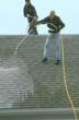 O'LYN's low pressure wash being applied to a roof.