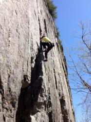 ROck climber ascends route in the Adirondacks