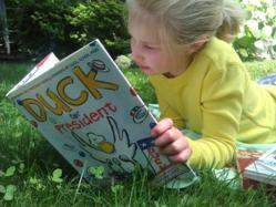 Girl reading the book Duck for President
