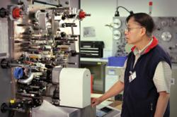 Electrocube employee at capacitor winding machine