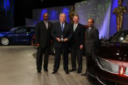 Pictured from left: Tony Brown, Group Vice President, Global Purchasing, Ford Motor Company; Tom Marino, President, Exotic Automation & Supply; Allan Mulally, President and CEO, Ford Motor Company; Raj Nair, Group Vice President, Production Development
