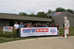 Stertil ALM Employees Standing with the 2,000th Unit Made in the USA