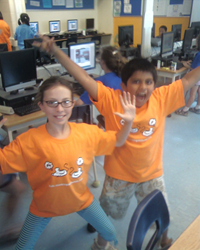 Two members of the Thinking Skills Club rejoice in their custom T-shirts