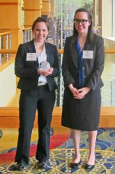 Amanda Boccuti and Kaley Huston posing with a 2012 Eco Leadership Award