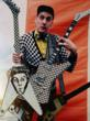Rick Nielsen, circa 1978, showcasing his Hamer Checkerboard Standard--the guitar that change it all.