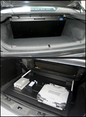 (Top) Fold-down Trunk Tray for Chevrolet Caprice in closed position; (Bottom) Fold-down Trunk Tray for Ford Interceptor in open position