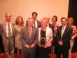 The leadership of Payroll Network, Inc., enjoy receiving the 'Organizational Member of the Year' award from the Greater Washington Society of CPAs.