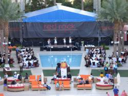 Attendees enjoy breakfast and entertainment poolside