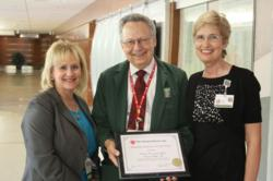 "Ron Vlcek of the Mended Hearts Arlington Heights chapter is pictured as he presents the ""Regional Hospital of the Year"" award to Bonnie DeGrande, NCH's director of Cardiovascular Services, and Mary Jo Dailey, NCH's director of Guest Services."