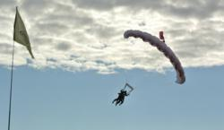 Winchester Chiropractor Kari Duggleby helping to break Guinness World Record for tandem skydiving