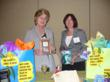 Linda Maria Frank and Karen Bonnet display their books at the Tee-Off, the opening event of the Executive Women's Golf Association