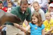 A delighted guest participates in the Sea Lion Show; Photo by Robin Winkelman/Saint Louis Zoo