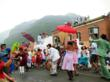 A colorful photo of jubilant parade participants on main street in downtown Telluride.