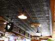 A tin ceiling works very well in this restaurant/bar