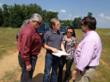 Architects Ken Rhyne and Luc Helterbrand of Urban Design Group look over proposedsite plans with Roxane Rose of the Humane Society of Jackson County and County ManagerKevin Poe in May.