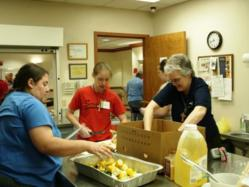 Sisters and volunteers help out in a soup kitchen during the 2011 Project Good Help.