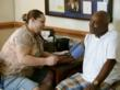 Volunteer Amy Smith gives free blood pressure checks during 2011 Project Good Help.