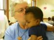 Sister Fran Gorsuch with a child at the Bon Secours Women's Resource Center.