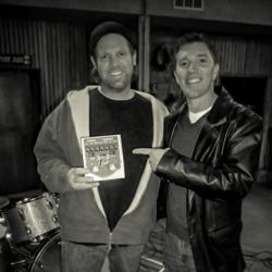 "Danny Rowe from the TBS sitcom ""The Wedding Band"" poses with Visual Sound owner Bob Weil on set."