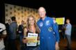 XCOR's Richard Searfoss (right) and Mercedes Becerra (left) of Paso Robles, Calif., winner of the trip to space given away at THE BIG BANG THEORY panel at Comic-Con 2012.