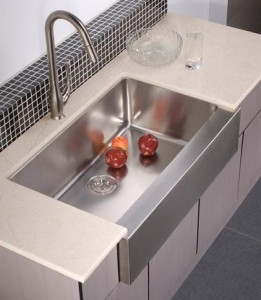 A Selection Stainless Steel Sinks and Modern Kitchen Faucets for a ...