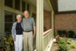 Sue and Jerry Palmer, standing in front of their Villa Home on Willows Breeze Court