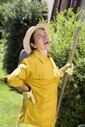 Yard work gives woman back pain and causes sleep problems.