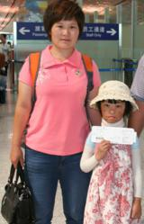 Burned Girl and Mother at Beijing Airport with mohter
