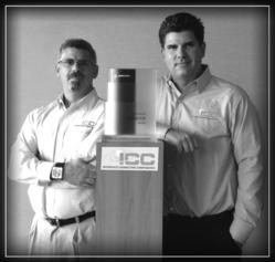 Scott Jacobs, President of ICC &amp; Craig Jacobs, Vice President of ICC pose with the Boeing Performance Silver Excellence Award.