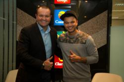 Guy Sebastian with the head of Choice Hotels Australasia
