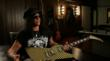 Slash holds Rick Nielsen's Hamer Checkerboard Standard.