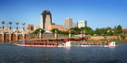 A photo of dragon boats in action at the Red River Dragon Boat Festival