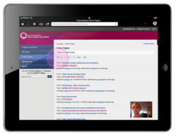 Session playback on an iPad. The pink circle indicates a tap by the user, who is shown in the lower right corner.