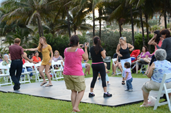 Residents dancing at July concert