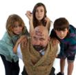 Three children from The I Hate Chldren Children's Show tormenting Bad Magician, Paul Nathan