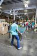 RESCUE! Employees have fun, breaking up the work day with a game of ping pong