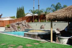 A rock pool slide san diego, artificial turf  and a palapa