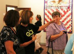 Alex Anderson discusses her 'Through the Years' quilt collection with quilting enthusiasts during the 3rd Annual Barn Quilt Unveiling