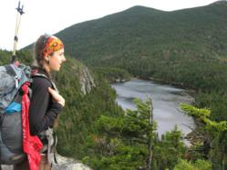 A hiker takes in the view of Horn Pond from Maine's section of the Appalachian Trail.