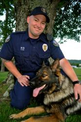 Officer Dean Ray with his K-9 Nitro