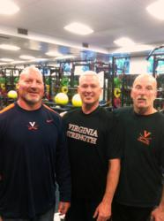 Coach Storms (middle) pictured with Head UVA Football Strength Coach Evan Marcus (left) and Director of the UVA Strength and Conditioning Department, Ed Nordenschild (right)