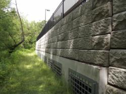 Precast concrete wall featuring flood mitigation products