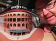 "Baseball Reliquary executive director Terry Cannon poses with ""The Ebbets Field Cake,"" created by confectionary artist William Robert Steele."