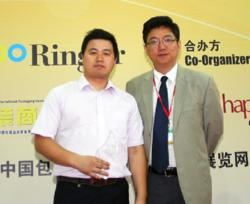 Microscan Applications Engineer Weijiang Song accepts the 2012 Ringier Technology Innovation Award for Microscan's new C-mount QX Hawk imager.