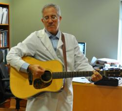 Spider vein therapy provider Steven Zimmet, playing guitar